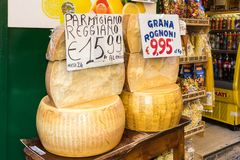 Rounds of cheeses for sale. Naples, Italy - 21st September 2017: Rounds of cheeses for sale outside a shop. Parmesan cheese is known the world over royalty free stock images