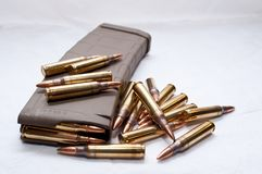 .223 rounds and a loaded magazine. Several .223 caliber rounds and a loaded magazine on a white backgroundn Stock Photography