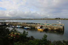 Roundstone, co. Galway, Ireland. A dock with boats in a picturesque town of Roundstone in Ireland stock photography