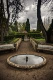 Roung Fountain. Small round fountain in a garden in a winter day with overcast sky stock image