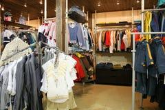 Roupa da criança na loja Foto de Stock Royalty Free