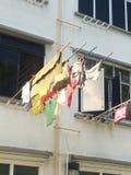 Roupa de secagem em um polo Imagem de Stock