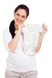 Roupa do bebê da mulher gravida foto de stock royalty free