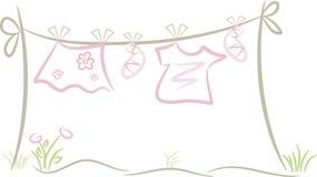 Roupa do bebê/menina na linha de lavagem ilustração royalty free