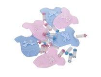 Roupa e frascos do bebê Imagem de Stock