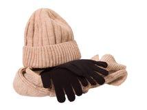 Roupa por uma estação fria: tampão, lenço e luvas de lã Fotografia de Stock