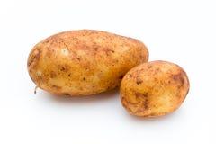 Rousse un fond blanc d'isolement bio par pomme de terre Image stock