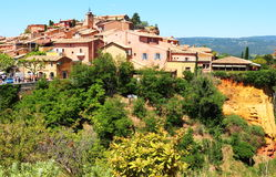 Roussillon, built upon ochre colored rocks, France Royalty Free Stock Photo