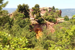 Roussillon, built upon ochre rocks in France Stock Images