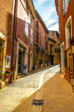 Roussillon, Provence. Beautiful alley in the ochre village of Roussillon in Provence royalty free stock images