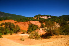 Roussillon, Vaucluse, France - view at the ochre mountains Royalty Free Stock Photography