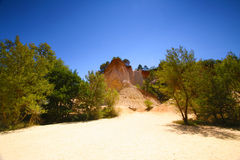 Roussillon, Vaucluse, France - view at the ochre mountains Royalty Free Stock Photos