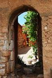 Roussillon village, France. Houses behind an arc in historical ocher village of Roussillon, Provence, France Stock Image
