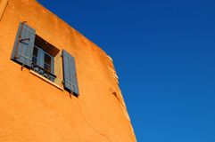 Roussillon window. Extraordinary colors of Roussillon (France) houses at sunset royalty free stock image