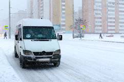 Rout taxi on city street during heavy snowfall Stock Photo