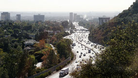Route 405 from the Hollywood Hills. Highway view with city in the background royalty free stock photo