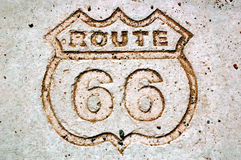 Route 66-1. Route 66 embossed in cement Royalty Free Stock Images