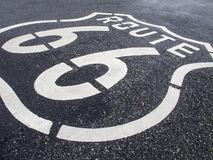 Route 66. Road sign painted into the road commemorating it's historical past Stock Photography