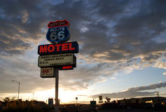 Route 66 Motel. Nostalgic Route 66 motel sign against cloudy sky in Seligman, Arizona Stock Image
