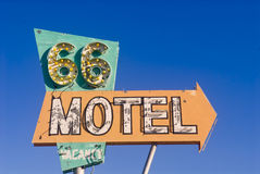 Route 66 motel sign from an abandoned motel. Old rusted Route 66 motel sign in front of an abandoned motel Stock Photography