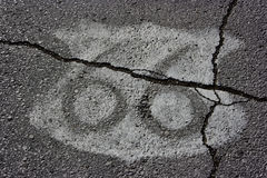 Route 66 Shield on Asphalt. Route 66 shield painted on Main Street USA in Carterville, Missouri. Large crack running through the image Stock Image