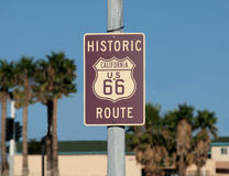 Route 66 Sign. Historic route 66 sign with palm trees in Southern California Stock Image