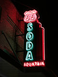 Route 66 Soda Fountain Sign. A neon red and blue sign advertising a soda fountain on historic Route 66 in Baxter Springs, Kansas Stock Images