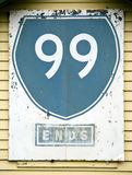 Route 99 Sign. Old American style sign reads Route 99 stuck onto a wall Royalty Free Stock Photo