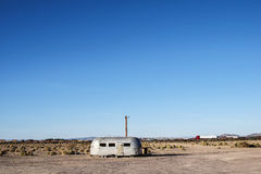 Route 66, abandonad camper trailer. NEWBERRY SPRINGS, CA, USA - MARCH 19, 2016: Abandoned trailer close to the famous Bagdad Cafe, Route 66, California Royalty Free Stock Photos