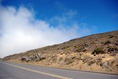 Route abandonnée dans la région sauvage photos stock