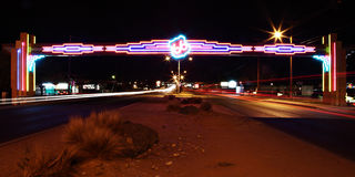 Route 66 Albuquerque. Neon Route 66 sign spanning Central Ave in Albuquerque, NM royalty free stock photo