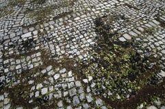 Route antique de trottoir de pavé - image courante Images stock
