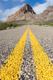 Route 66 in arizona with mountain in the background. Low angle view of route 66 through arizona Stock Photo