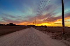 Route au coucher du soleil Image libre de droits