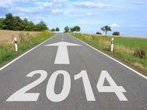 Route avec la flèche à l'année 2014 Images stock