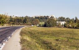 Route avec la maison Images stock