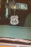 Route 66 badge hanging on a car mirror Royalty Free Stock Image