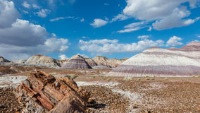 Route 66: Blue Mesa, Painted Desert, AZ. Petrified wood amidst towering hills with colorful bands of silt, sand, and gravel. Blue Dome trail, Petrified Forest Royalty Free Stock Photography