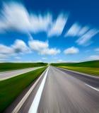Route brouillée par mouvement Photos stock