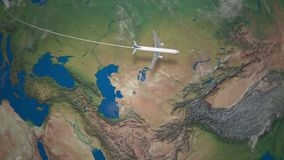 Route of commercial airplane flying from Paris to Beijing on the Earth globe stock footage