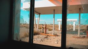 Route 66. crisis road 66 fueling broken window slow motion video. lifestyle Old dirty deserted gas station. U.S. closed. Supermarket store shop Abandoned gas stock footage