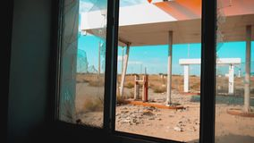 Route 66. crisis road 66 fueling broken window slow motion video. Old dirty deserted gas lifestyle station. U.S. closed. Supermarket store shop Abandoned gas stock video