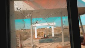 Route 66. crisis road 66 fueling broken window slow motion video. Old dirty deserted gas station. U.S. closed. Supermarket store shop Abandoned gas station oil stock footage