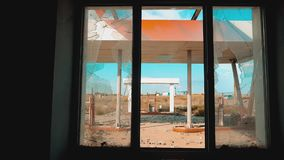 Route 66. crisis road 66 fueling broken window slow motion video. Old dirty deserted gas station. U.S. closed. Supermarket store shop Abandoned gas station oil stock video footage