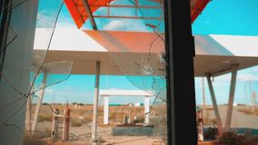 Route 66. crisis road 66 fueling broken window slow motion video. Old dirty deserted gas station. U.S. closed. Supermarket store shop lifestyle Abandoned gas stock video