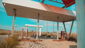 Route 66. crisis road 66 fueling slow motion video. Old dirty deserted gas station lifestyle. U.S. closed supermarket. Store shop Abandoned gas station oil end stock video