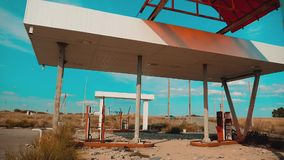 Route 66. crisis road 66 fueling slow motion video. Old dirty deserted gas station. U.S. closed lifestyle supermarket. Store shop Abandoned gas station oil end stock video