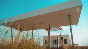 Route 66. crisis road 66 fueling slow motion video. Old dirty deserted gas station. U.S. closed supermarket store shop. Abandoned gas station oil end of fuel stock video footage