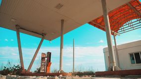 Route 66. crisis road 66 fueling slow motion video. Old dirty deserted gas station. U.S. closed supermarket store shop. Abandoned gas station lifestyle oil end stock video