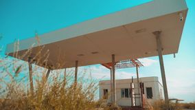 Route 66. crisis road 66 fueling slow motion video. Old dirty deserted gas station. U.S. closed supermarket store shop. Abandoned gas station oil end of fuel stock video